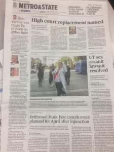 Statesman cover of B section showing photo of fake Donald Trump surrounded by dancers in a crosswalk
