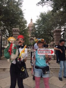 Two clowns in front of the Austin capitol