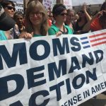 Members of the Resistance Choir of South Central Texas hold a Moms Demand Action Banner